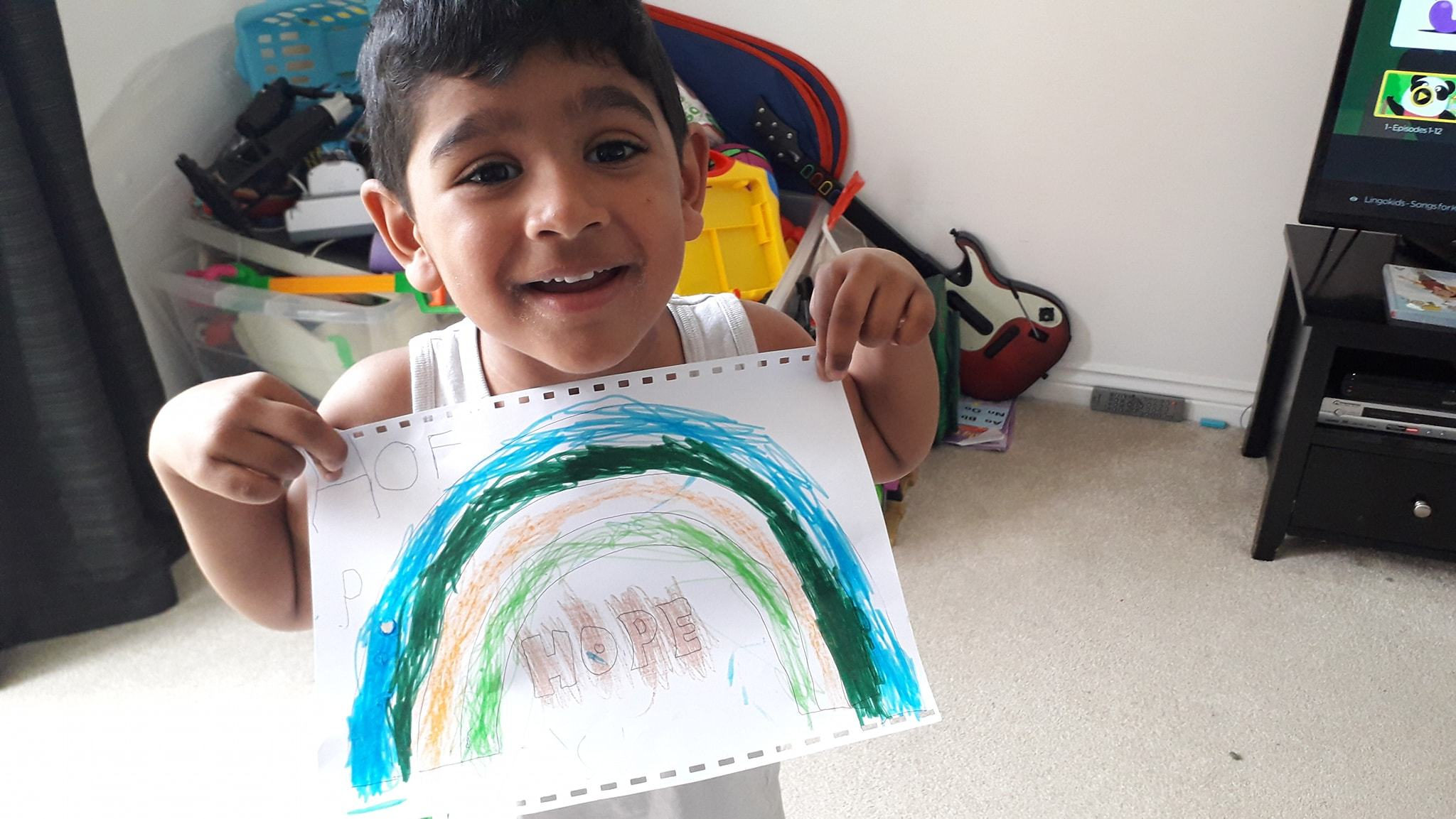 4-year-old-Joel-with-his-rainbow-picture-Gurmeet-Chauhans-photo